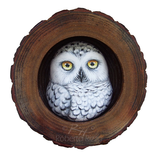 Hand painted snowy owl in the nest