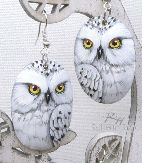 Pair of painted snowy owl earrings
