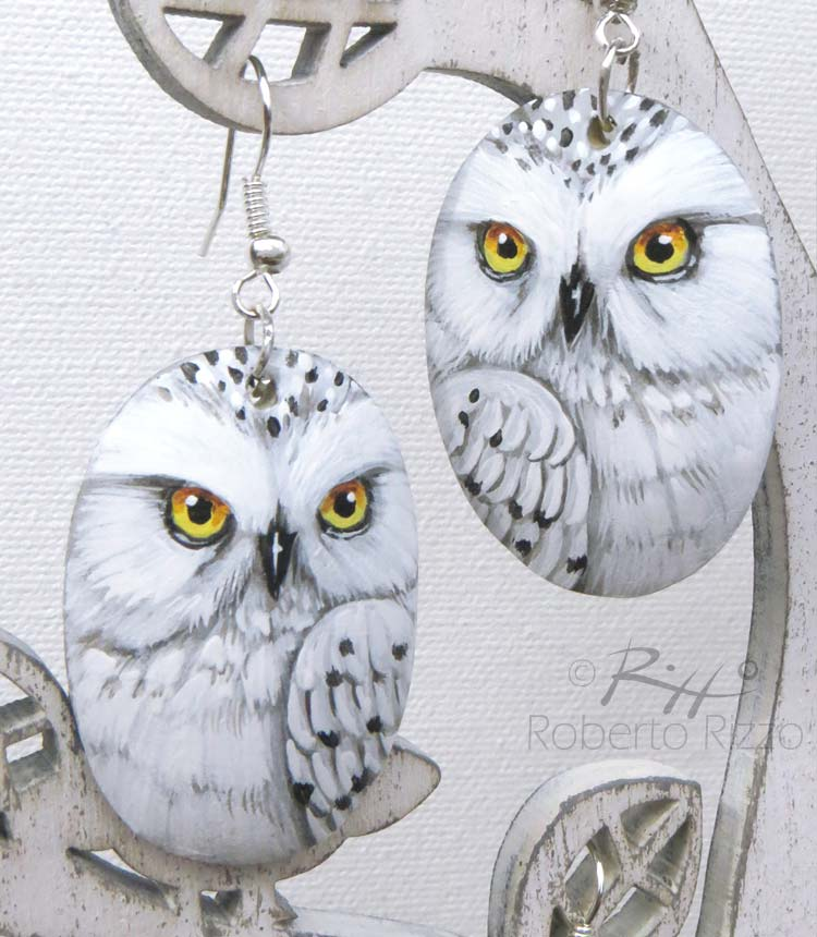 Pair of painted snowy owl earrings