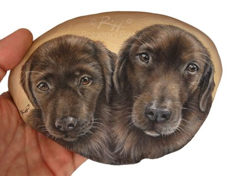 Two Dogs Painted On Rock