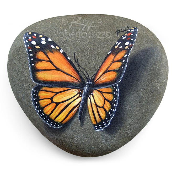 Monarch butterfly painted on rock